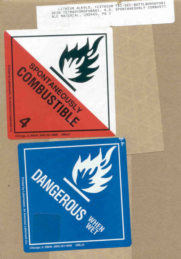 "Labels stating ""Spontaneously Combustible"" and ""Dangerous when wet"""