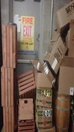 Example of a fire exit being blocked by wooden crates