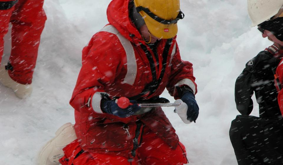 Researchers taking samples of the snow