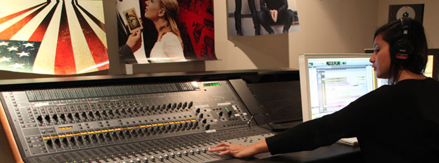 Student working the soundboard in the media lab