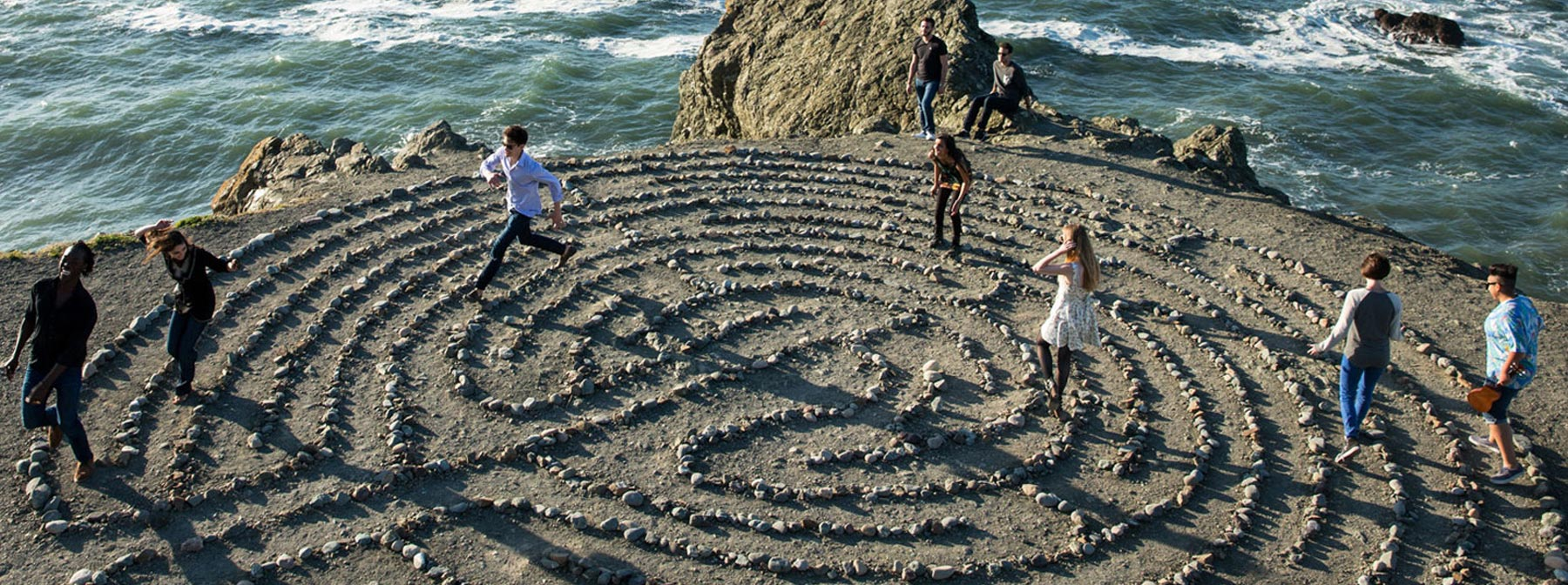 Students running through the stone maze at SF's Land's End park