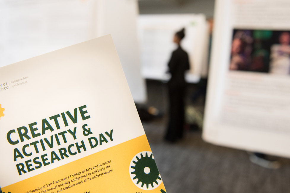 CARD day brochure with research presentations in the background