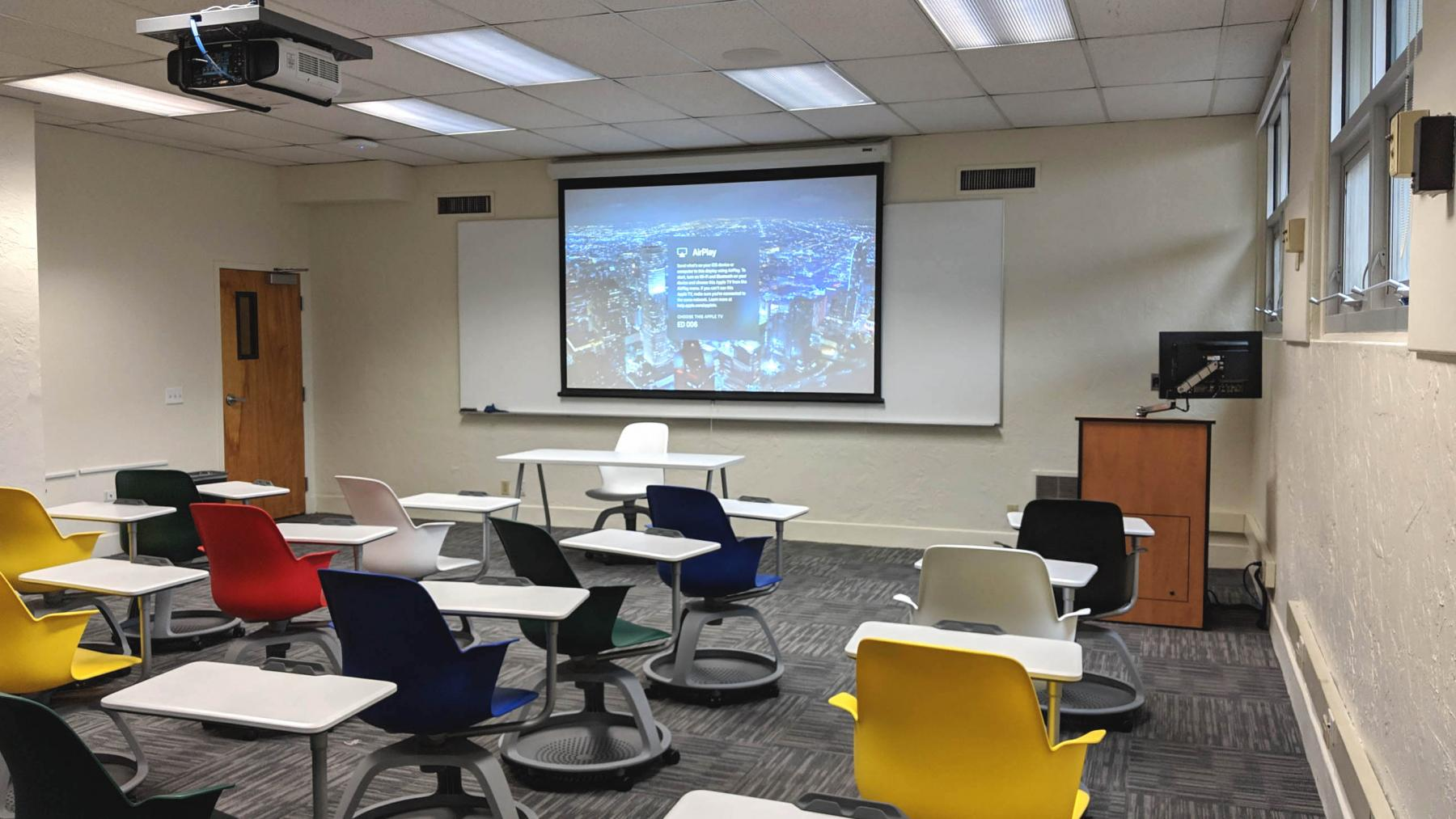 Classroom with a projected image showing directions for connecting to wireless AV