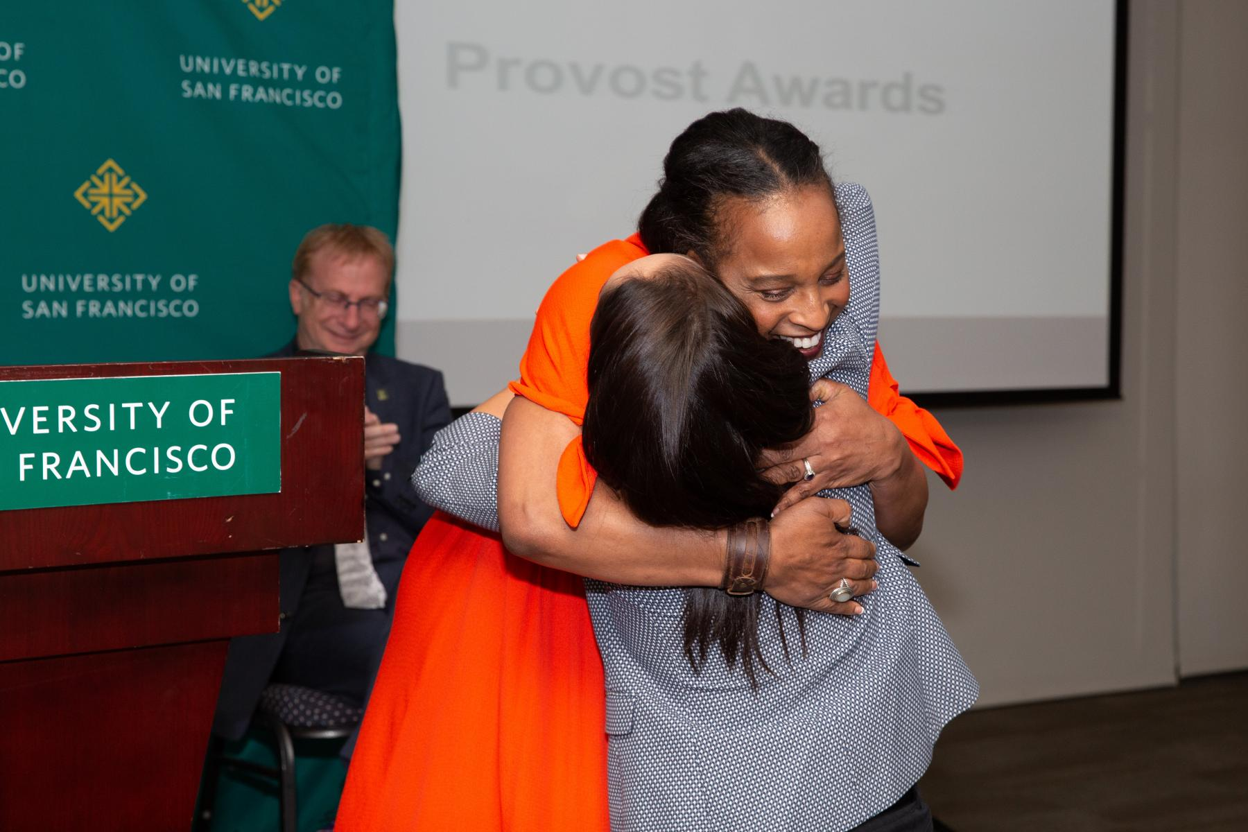 Dr. Mary J. Wardell-Ghirarduzzi hugging Dr. Daniela Dominguez during the 2019 Service and Merit Awards.
