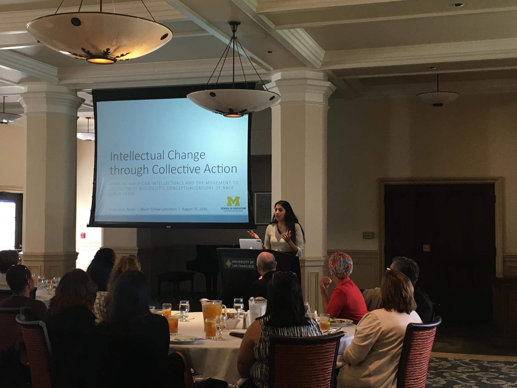 Kimberly A. Reyes, 2016-17 Gerardo Marín Dissertation Fellow, presenting at a welcome luncheon