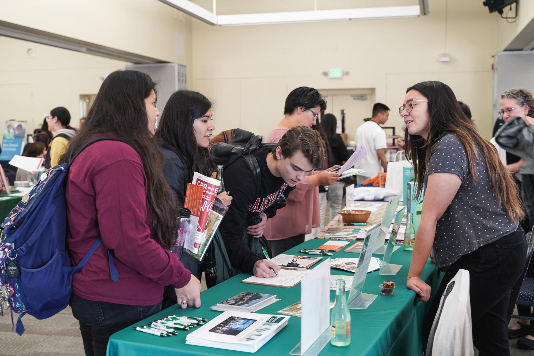 Students Networking at Health Fair for Employment Opportunities