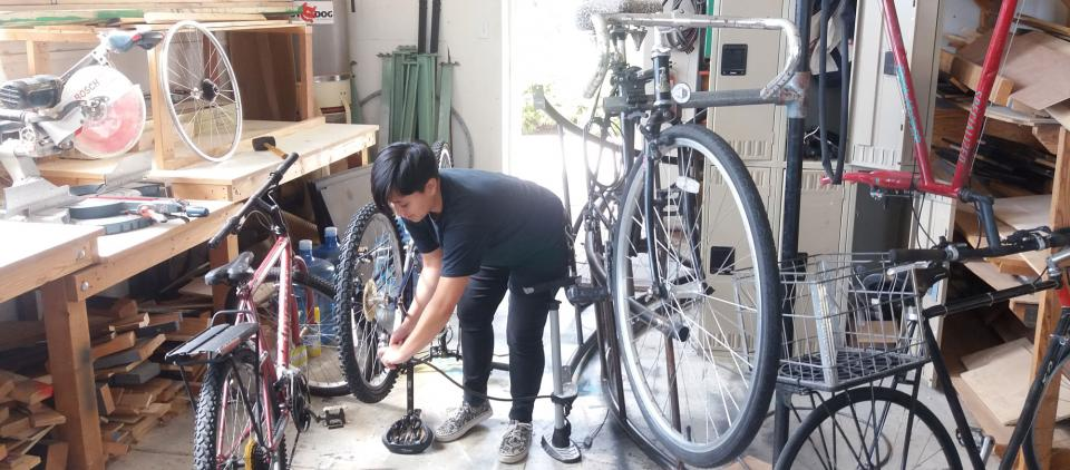 student working on bike