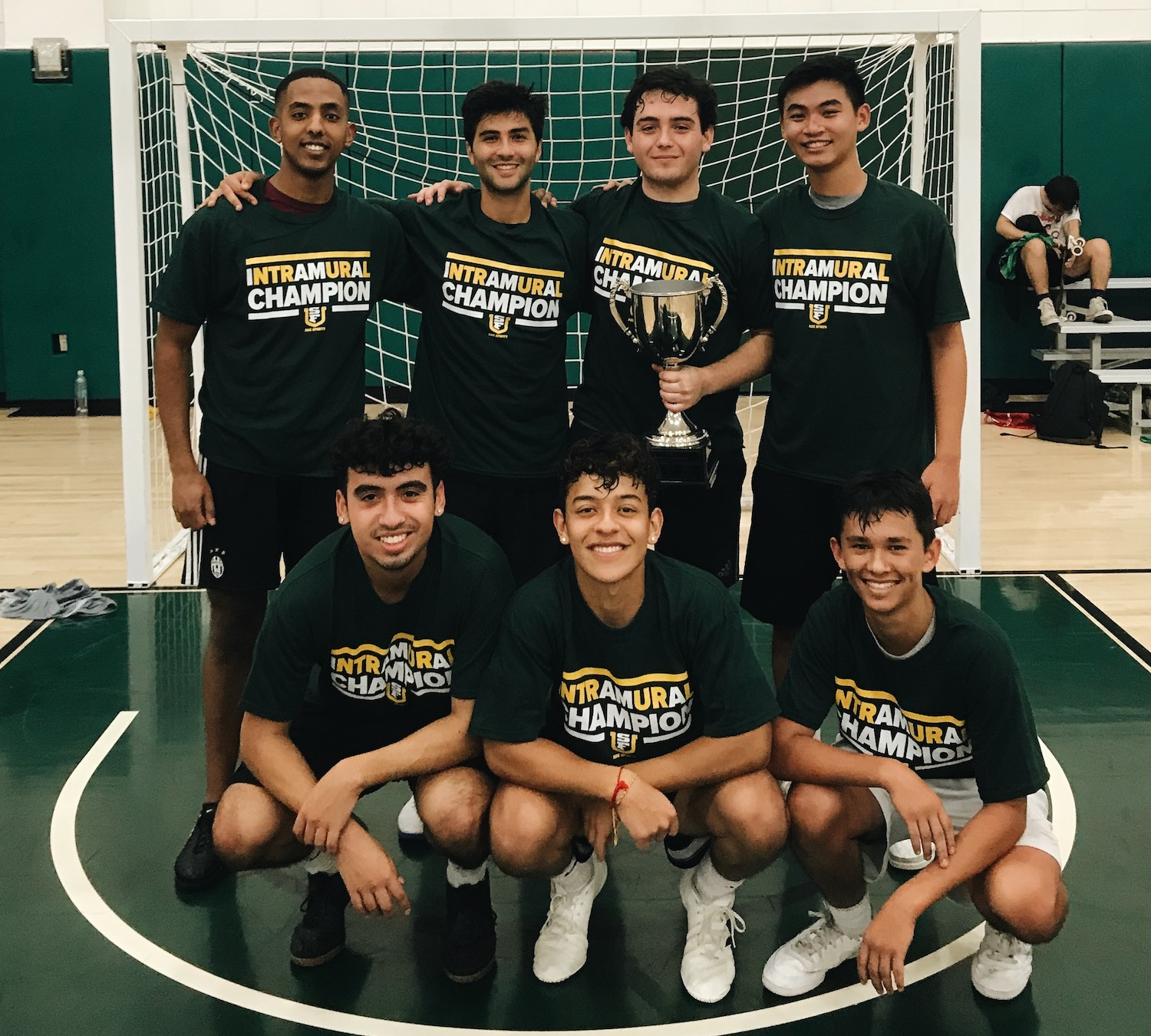 Fall 2019 Indoor Soccer Champion Hoofhearted Standing Together with Trophy