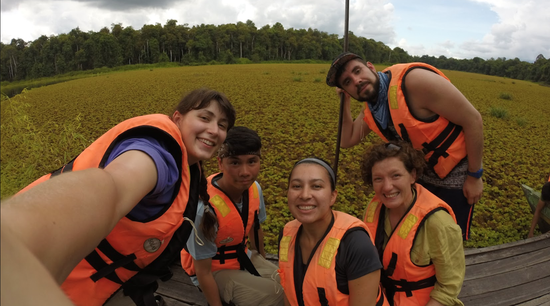 selfie of a group of students wearing life jackets
